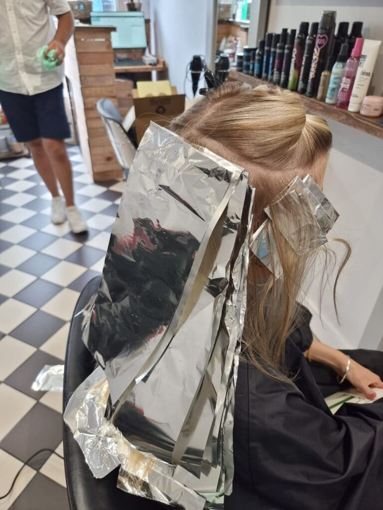 Blonde hair during colouring process