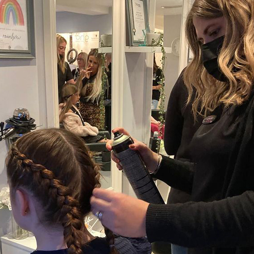 Braids being styled at the Big Hair Do 2021